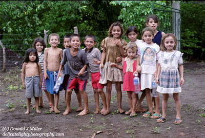 While on volunteer medical clinic in rural El Salvador, these children who used the local streams to bath and drink eagerly gathered our water bottles as we drank them in the hot humid jungle. To them they were a novel treasure.